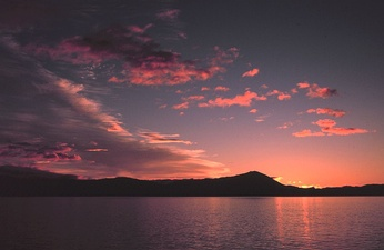 Sunrise in southeast Alaska. Sunsets and sunrises are sometimes pink because of an optical effect called Rayleigh scattering.