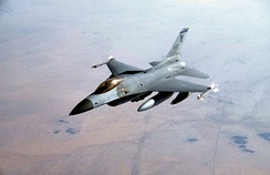F-16C block 25 #85-1405 from the 10th TFS armed with Mark 84 2,000-pound bombs mounted under its wings and AIM-9 Sidewinder air-to-air missiles on its wing tips during the second wave of air attacks on Iraqi targets in support of Operation Desert Storm on 17 January 1991.