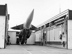 An RCAF CIM-10 Bomarc missile on a launch erecter in North Bay. Viewed as an alternative to the scrapped Avro Arrow, the Bomarc's adoption was controversial given its nuclear payload.