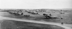 5 June 1944 photograph of C-47s of the 95th and 98th Troop Carrier Squadrons at RAF Exeter with freshly applied black/white invasion stripes to aid in aircraft identification from the ground. There was insufficient space to park all the aircraft on the concrete, so many were parked on grass turf.