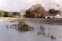 A levee keeps high water on the Mississippi River from flooding Gretna, Louisiana, in March 2005.