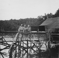 This 1944 officers' club was a bar for off-duty officers of the VII Amphibious Force ships. Despite its primitive appearance, the breeze off Yos Sudarso Bay brought relief from the smells and insects ashore.