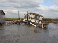 Tipped and flooded home, Terrebonne Parish, Louisiana.