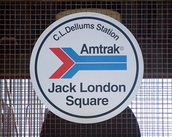 Classic Amtrak logo displayed at the Oakland – Jack London Square station, California