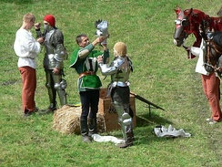 A squire helping his knight, in a historical reenactment in 2009