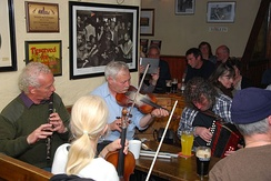 Irish traditional music sessions usually take place in public houses