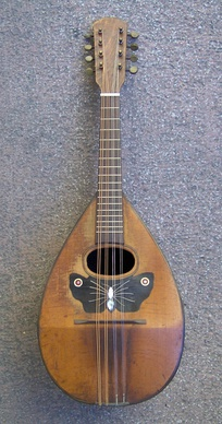 Mandolin, dominant instrument of the Heptanesian music.