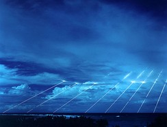 Time exposure shot of testing of the Peacekeeper re-entry vehicles at the Kwajalein Atoll, all eight fired from one missile.