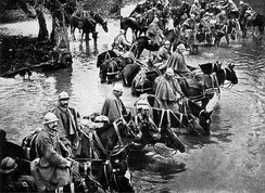 French horsemen crossing a river on their way to Verdun.