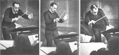 Igor Stravinsky conducting with a baton (1929).