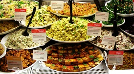 A variety of vegan and vegetarian deli foods.