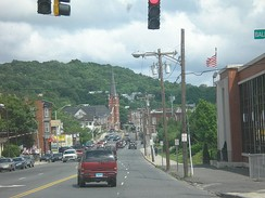 Looking east on East Main Street in Waterbury, Sacred Heart Church in center
