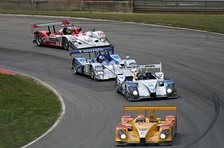A group of modern Le Mans Prototypes competing in the American Le Mans Series