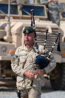 "A Canadian bagpiper playing ""Amazing Grace"" during a memorial service, October 29, 2009, at Forward Operating Base Wilson, Afghanistan"