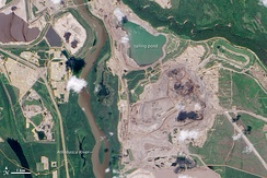The Athabasca oil sands are an example of anthropization as a result of the harvest and transport of a non-renewable resource, oil sands.
