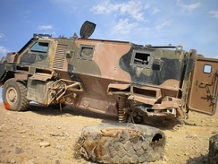 A Bushmaster damaged after striking an improvised explosive device