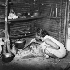 A traditional humble kitchen in Indonesia using firewood for cooking.