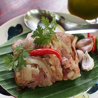 Chin som mok is a northern Thai speciality made with grilled, banana leaf-wrapped pork (both skin and meat) that has been fermented with glutinous rice