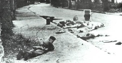 Belgian soldier lying in front of dead hostages, November 1964, in Stanleyville during Operation Dragon Rouge. Belgian paratroopers freed over 1,800 European and American hostages held by Congolese rebels.