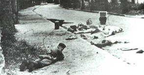 Belgian soldier lying in front of dead hostages, November 1964, in Stanleyville during Operation Dragon Rouge. Belgian paratroopers freed over 1,800 European and American hostages held by Congolese rebels