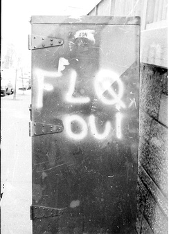 A postal box in Montreal bearing the graffiti FLQ oui (FLQ yes) in July 1971. The FLQ conducted several bombings of post boxes which typically bore a decal of the Royal Coat of Arms of Canada.