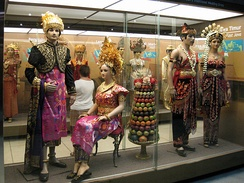 Exhibit in Indonesia Museum, Jakarta, displaying the traditional costumes of Indonesian ethnic groups, such as Balinese and East Java.