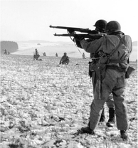 Landscape shot of soldiers moving across a desolate landscape