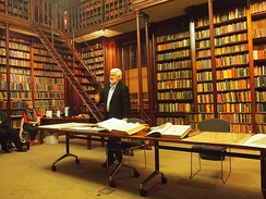 Using items from its rare books collection, Keith Conlon gives a talk on the 200th anniversary of the death of Matthew Flinders, at the SLSA's Institute Building, 21 July 2014.
