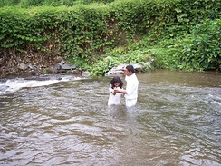 An eight-year-old girl being baptized in Cerro Punta, Panama