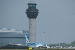 The new control tower, opened in June 2013, with a Thomson Airways Boeing 787 Dreamliner taxiing in at the end of its delivery flight.
