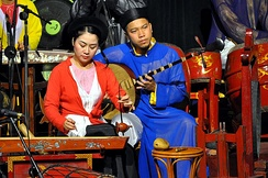 Đàn bầu musician performing at the Hanoi Water Puppets Theatre