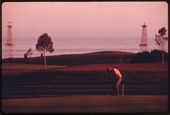 Sandpiper Golf Course with derricks in background, 1975. Photo by Charles O'Rear.