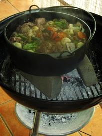 Potjiekos is a traditional Afrikaner stew made with meat and vegetables and cooked over coals in cast-iron pots.