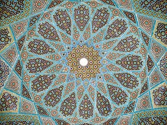 Geometric arabesque tiling on the underside of the dome of Hafiz Shirazi's tomb in Shiraz, Iran