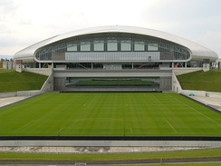 Retractable grass field shown outside the stadium