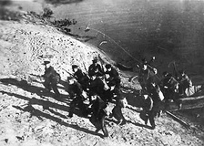 Soviet Marines charge the Volga river bank.