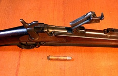 Springfield Trapdoor Rifle with breech open. Custer's troops were equipped with these breech-loading, single-shot rifles.