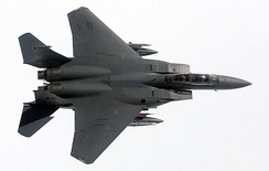 A wing-over maneuver displays the clean lines and high-wing design of an F-15E from Elmendorf AFB, Alaska