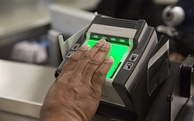 A fingerprint scanner at Dulles International Airport collects biometric data on visitors, which can be used for confirming identities.