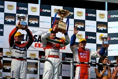 Whincup celebrates on the podium of the 2008 Clipsal 500 Adelaide.