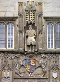 The statue of the college's founder Henry VIII presiding over the Great Gate, with a chair leg in his right hand
