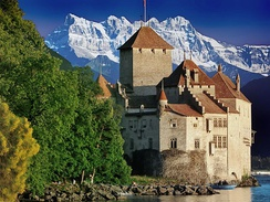 Château de Chillon, an early medieval castle on the north shore of Lake Geneva, is shown here against the backdrop of the Dents du Midi.