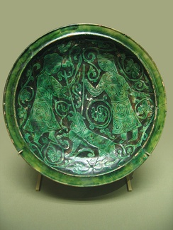 Bowl with hunters, Persian pottery from 12th–13th century.