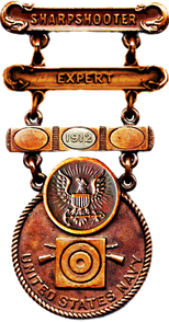 Former U.S. Navy Sharpshooter's Badge with Expert Clasp and Qualification Year Clasp with 1912 Year Disk
