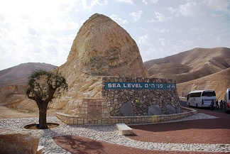 This marker indicating sea level is situated between Jerusalem and the Dead Sea.