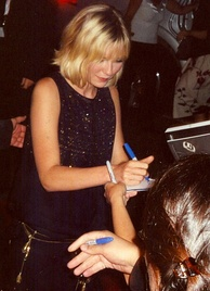 Dunst signing autographs at the Toronto International Film Festival in 2005