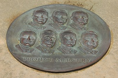 Circular plaque with the faces of the seven astronauts