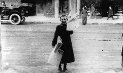 A newsboy in 1905 selling the Toronto Telegram in Canada