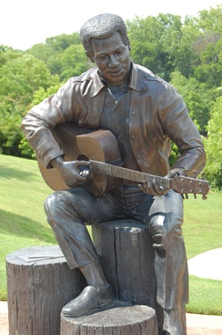 """Otis Redding Sittin' on the Dock of the Bay"", statue in Gateway Park by Bradley Cooley and Bradley Cooley, Jr of Bronze By Cooley, 2003"