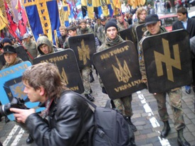 "Protesters with neo-Nazi symbols – SS-Volunteer Division ""Galicia"" and Patriot of Ukraine flags"